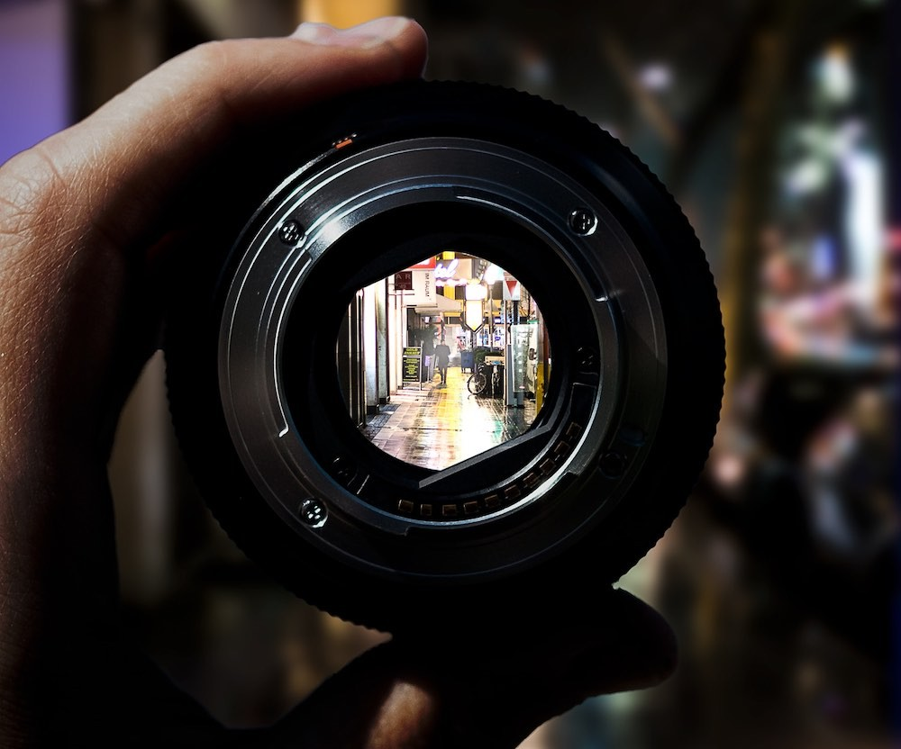 Looking through aperture of camera lens