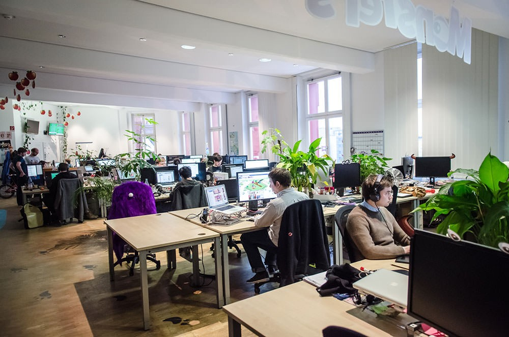 Tech startup workers in open plan office